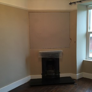Area above fireplace showing plasterboard
