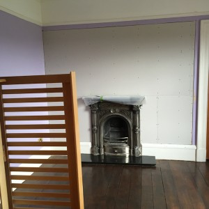 Area around fireplace showing plasterboard