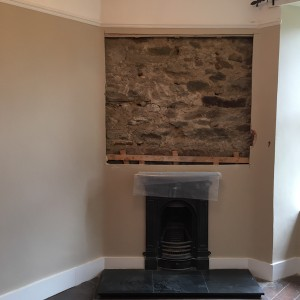 Exposed area above fireplace