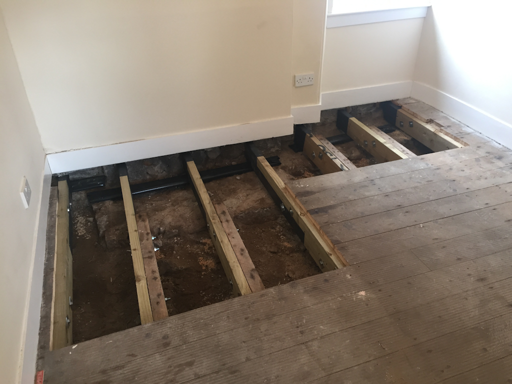 new joists bolted onto old joists